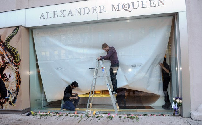 A makeshift memorial develops at Alexander McQueen's Manhattan store on the day the celebrated fashion designer was found dead at his London home
