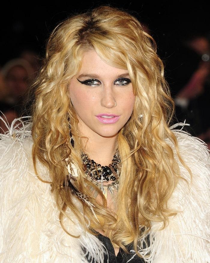 Kesha with false lashes and bubblegum pink lips