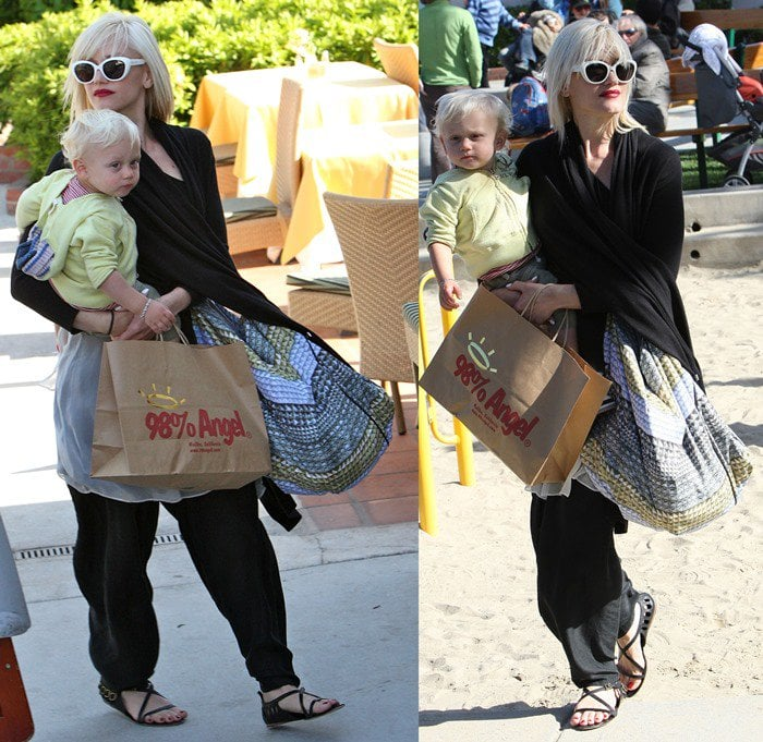 Gwen Stefani in Malibu wearing a pair of L.A.M.B. Dacey sandals featuring cutouts and buckled strap details at the heel