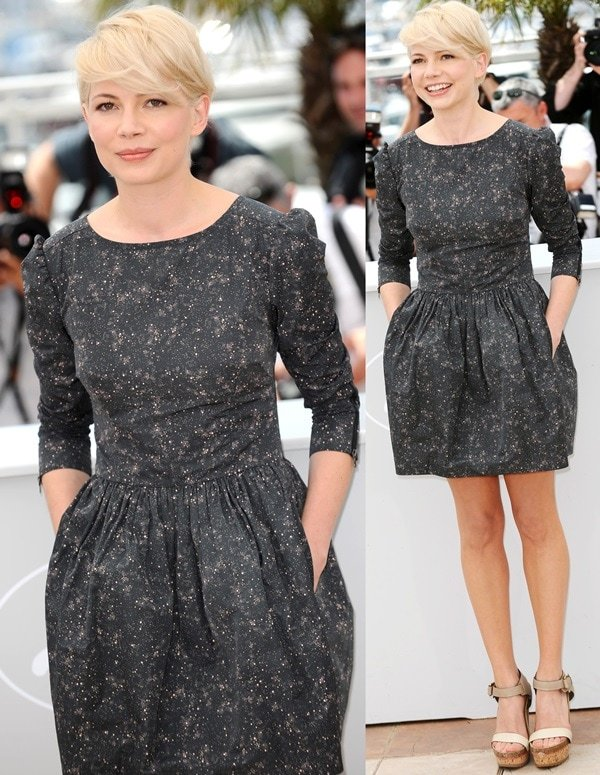 Michelle Williams's light hair is a wonderful contrast to her blue black Suno dress