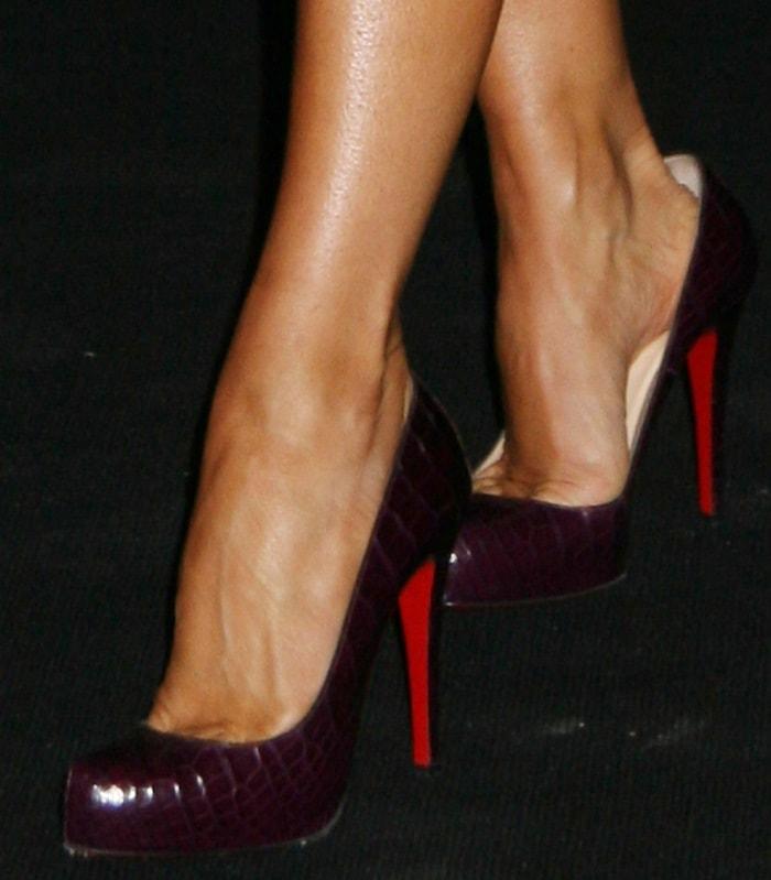 Victoria Beckham wearing snakeskin Christian Louboutin pumps