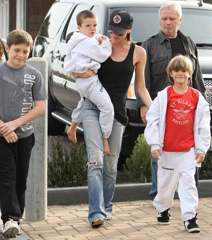 Victoria Beckham with her father, Tony Adams and her sons Cruz Beckham, Romeo Beckham and Brooklyn Beckham leaving Tra Di Noi restaurant in Malibu on January 31, 2010