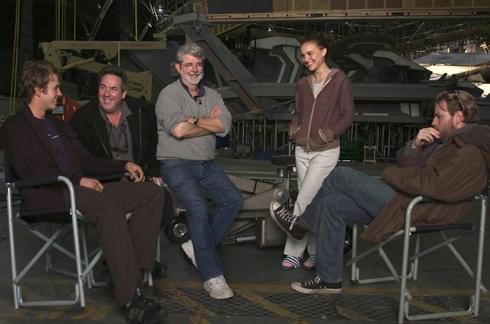 (Left to right) Hayden Christensen, Producer Rick McCallum, Writer-Director George Lucas, Natalie Portman, and Ewan Gordon McGregor OBE gather on the first day of shooting of Star Wars: Episode III Revenge of the Sith
