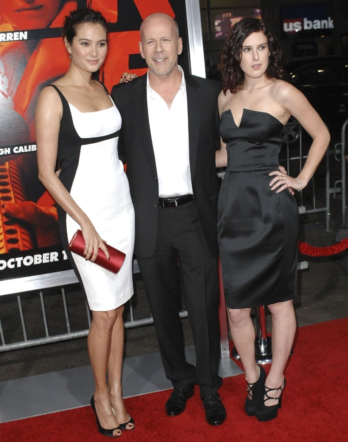 "Rumer Willis, posing with Emma Heming and Bruce Willis, is wearing black YSL ""Palais"" strappy platforms pumps"