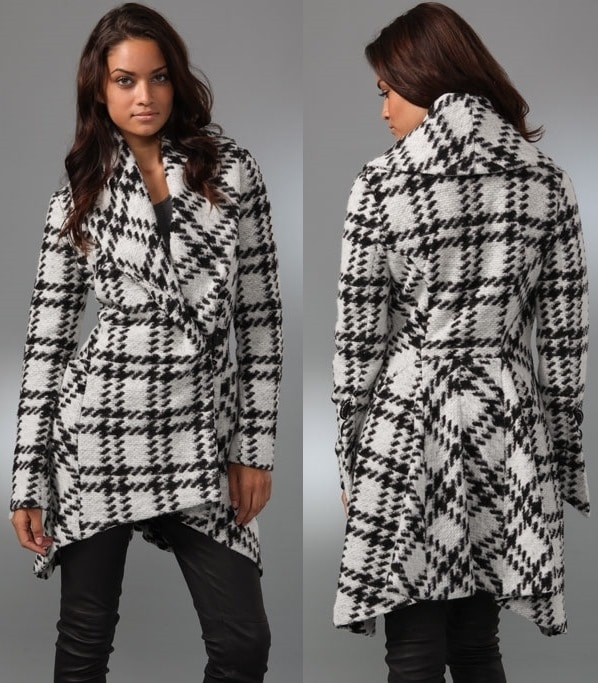 This plaid coat features a shawl collar and a leather hook-and-eye closure