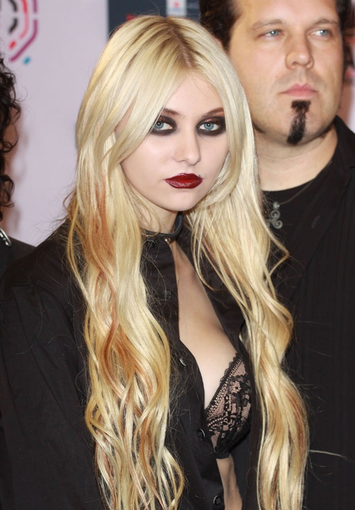 Taylor Momsen wore a guy's shirt, buttoned lopsided and halfway