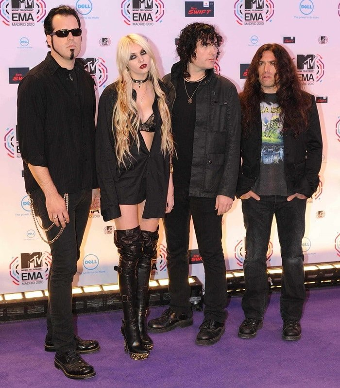 Taylor Momsen and The Pretty Reckless pose in front of the media boards at the MTV Europe Music Awards 2010 at La Caja Magica on November 7, 2010 in Madrid, Spain