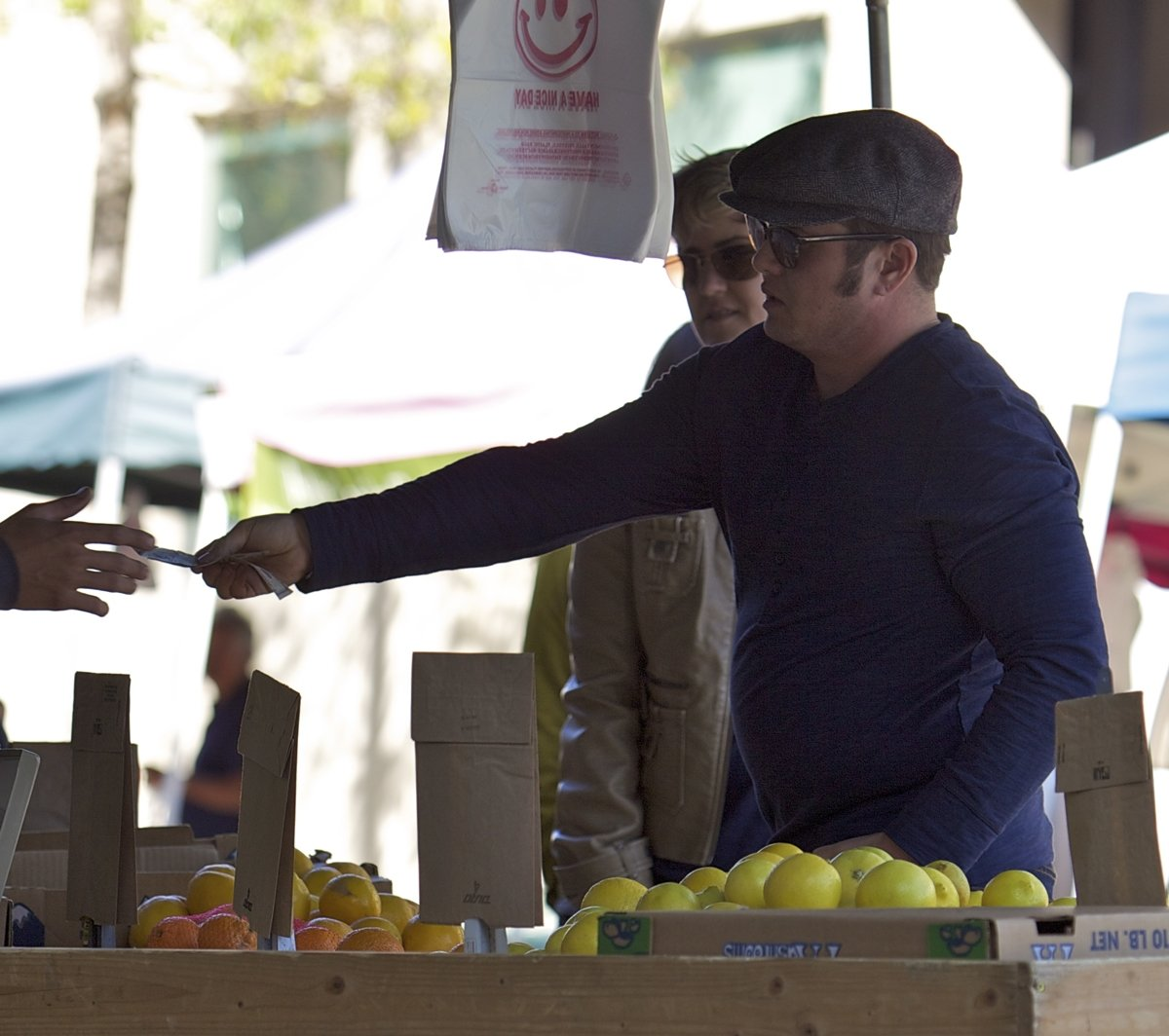 Chaz Bono buys healthy fruits and vegetables from a local farmers market