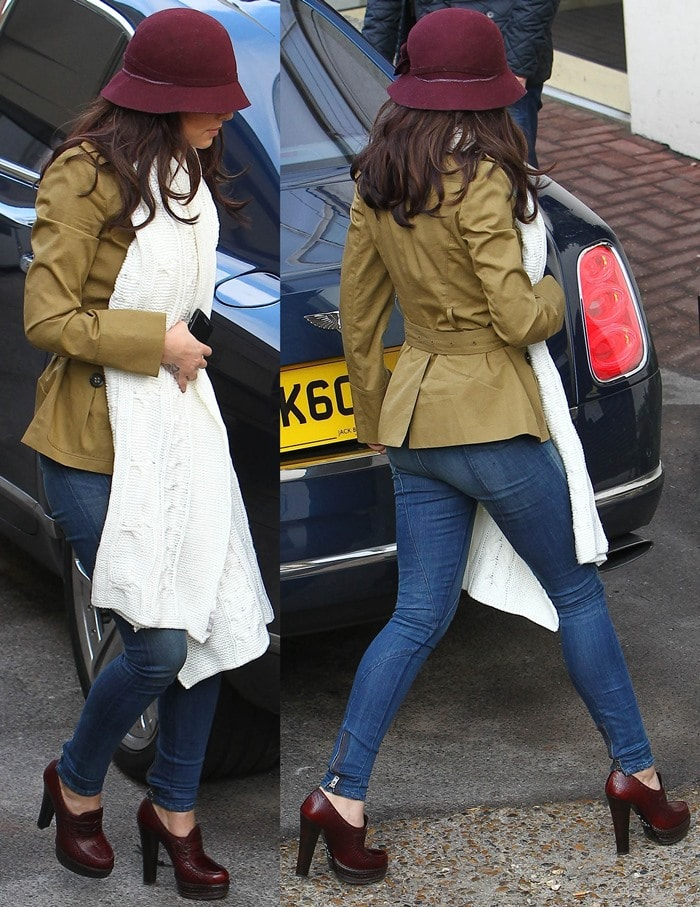 Cheryl Cole tops her dark brown tresses with a burgundy felt hat that matches her Prada loafer pumps
