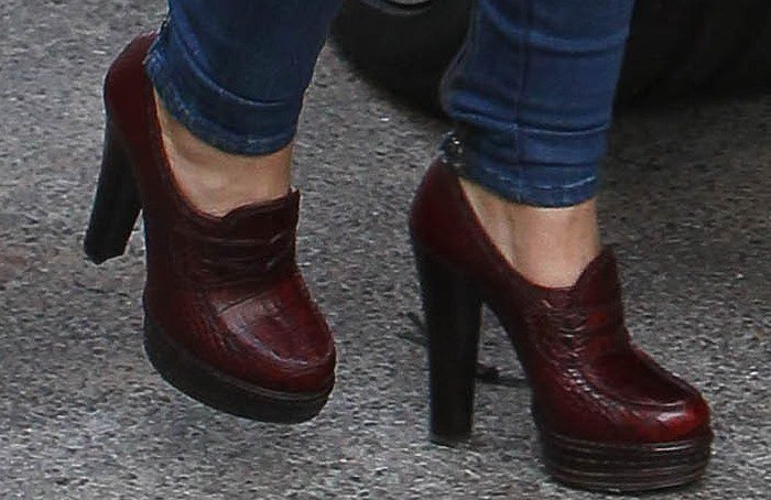 Cheryl Cole shows off the detail on her Prada loafer pumps