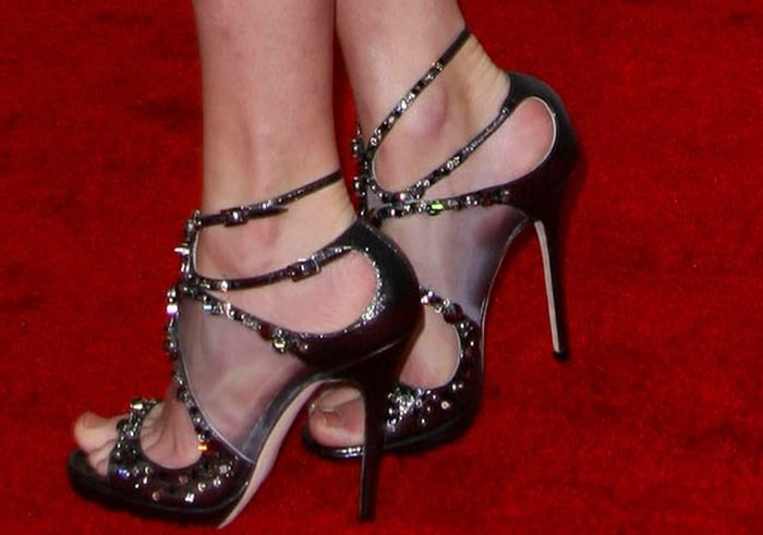 Taylor Swift's feet in Jimmy Choo sandals featuring scattered Swarovski crystals