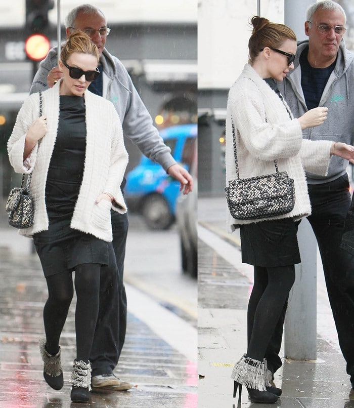 Kylie Minogue leaves her house in the rain while wearing a pair of chain fringe booties and a Chanel Ice Cube purse