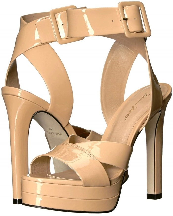 The Massimo Matteo Henrika Pump platform sandal flaunts a strappy leather upper and a wrapped heel, for a sexy addition to your collection