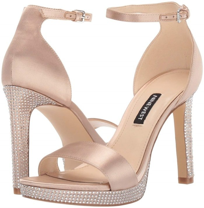 Take your style to the next level with these nude Nine West Edyn heeled sandals
