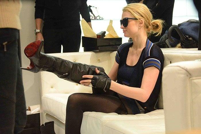 Paris Hilton shoe shopping at luxury shoe store Cesare Paciotti