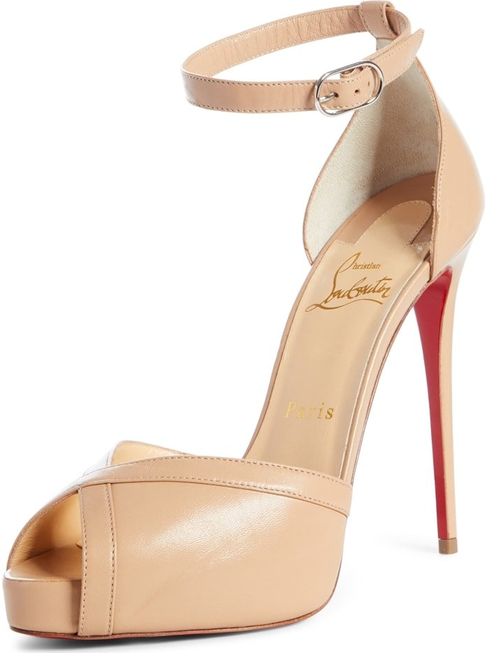 A willowy stiletto heel and wrapped platform send this peep-toe pump skyward, while a slender ankle strap secures the major style