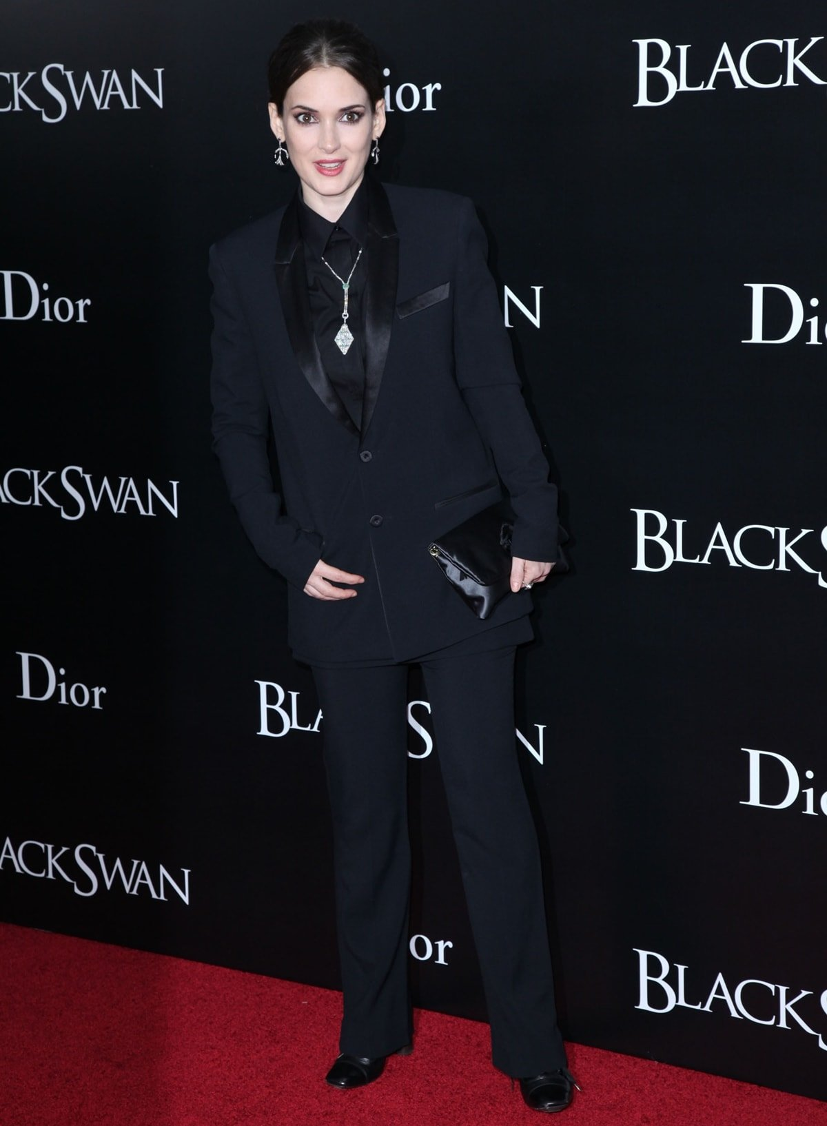 Winona Ryder styled a black Givenchy Resort 2011 suit with Stephen Russell jewelry and a Lanvin Ouloulette satin brooch clutch