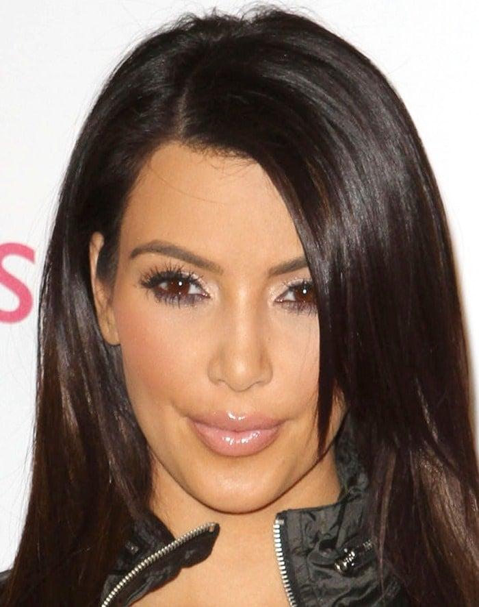 32c2b5fc4c357 Kim Kardashian Trades Trainer for Sneakers in Skechers Super Bowl Ad
