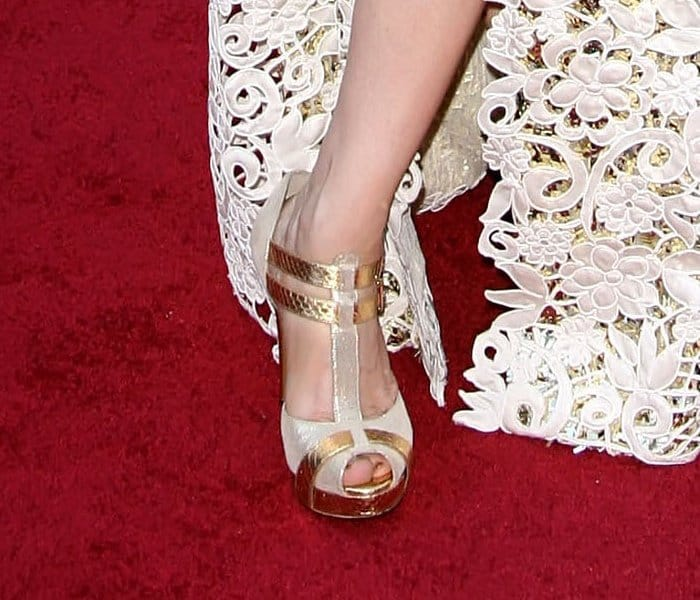 Melissa Leo shows off her feet in gold python strap peep toe sandals