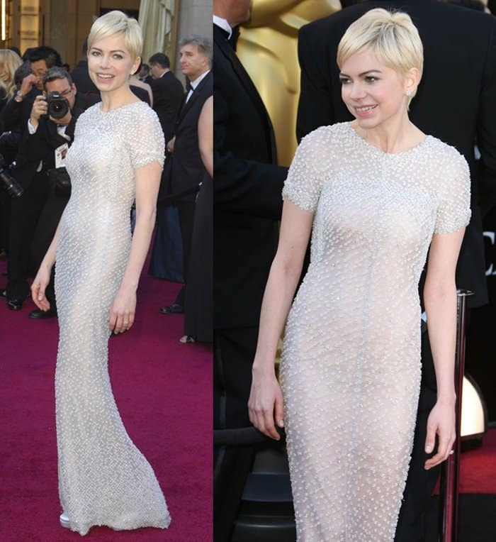 Michelle Williams attends the 2011 Oscars wearing an embellished Chanel Couture gown.