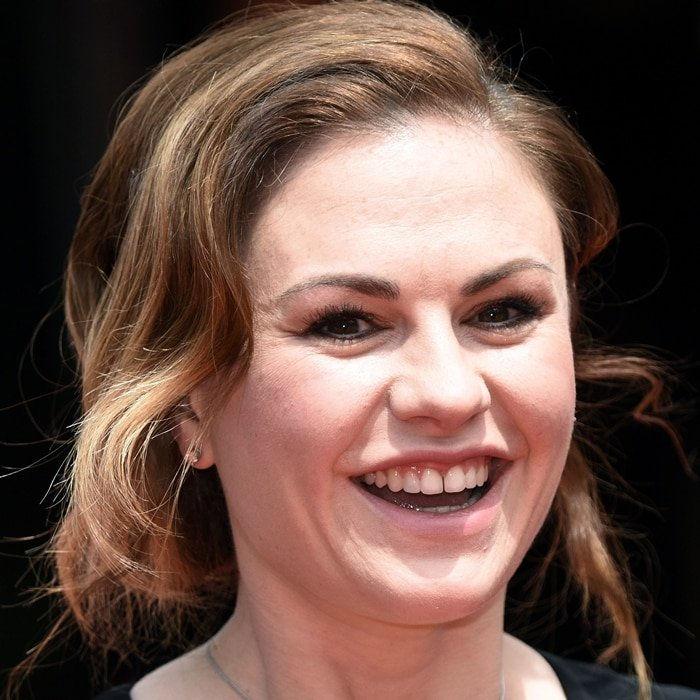 Anna Paquin has promised not to fix the teeth she showed off at the premiere of The Parting Glass