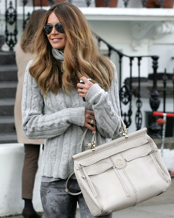 Elle MacPherson toting a Roberto Cavalli 'Diva' bag for a school run in West London on March 14, 2011