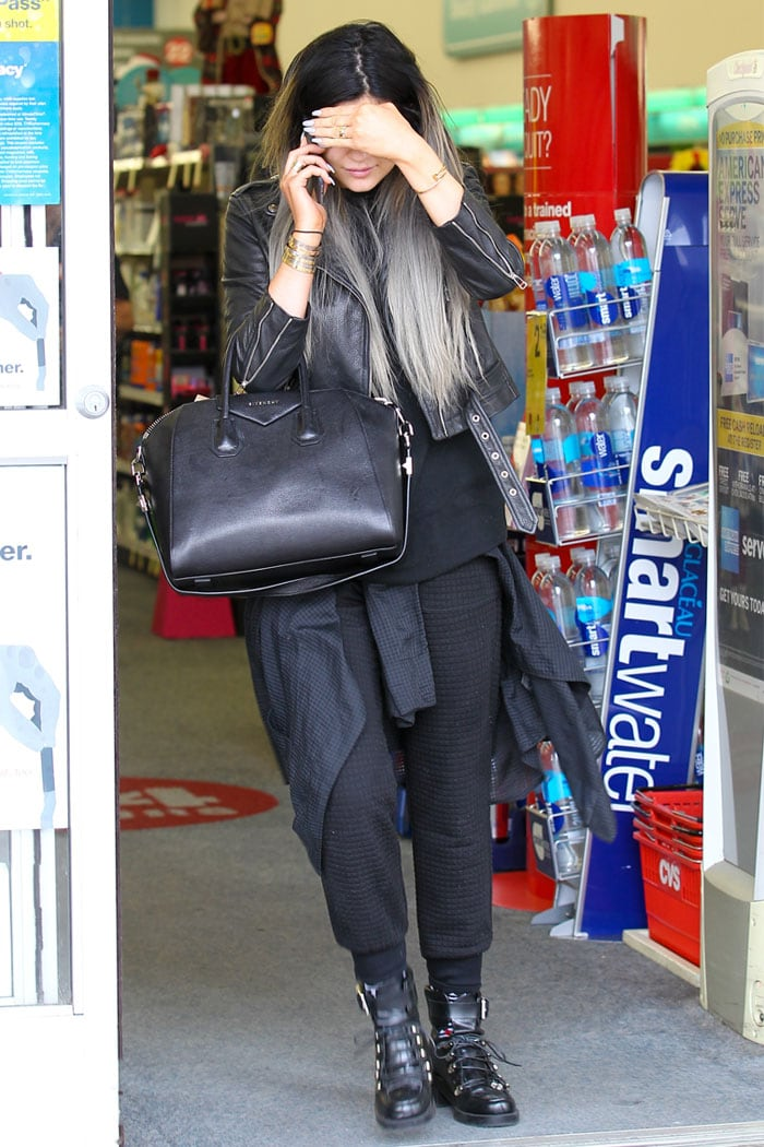 Kylie Jenner hiding her face while shopping at CVS Pharmacy