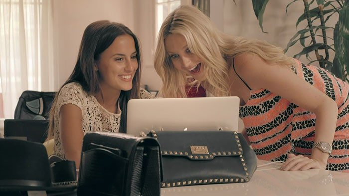 "Lucy Watson and Stephanie Pratt looking at a laptop on an episode of the television series ""Made in Chelsea: LA."""