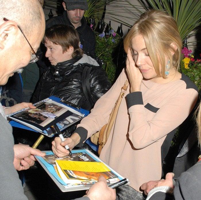 Sienna Miller Signing Autographs