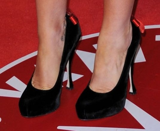 Anna Paquin's pumps are the Brian Atwood 'Donna' ribbon-embellished platform pumps from the Fall 2010 collection