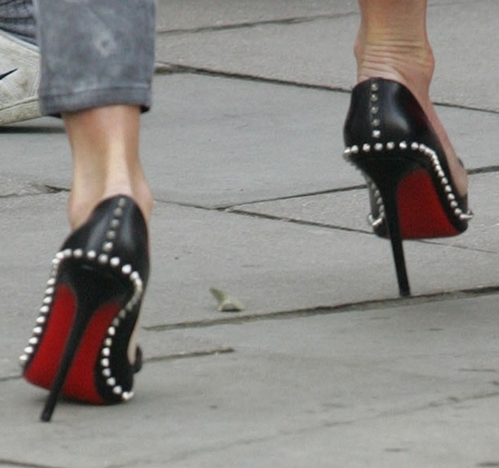Elle MacPherson rocking Christian Louboutin Lucifer spike bow pumps