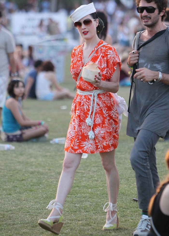 Dita Von Teese opted for a kimono dress and capped off the look with a sailor hat and the same espadrilles