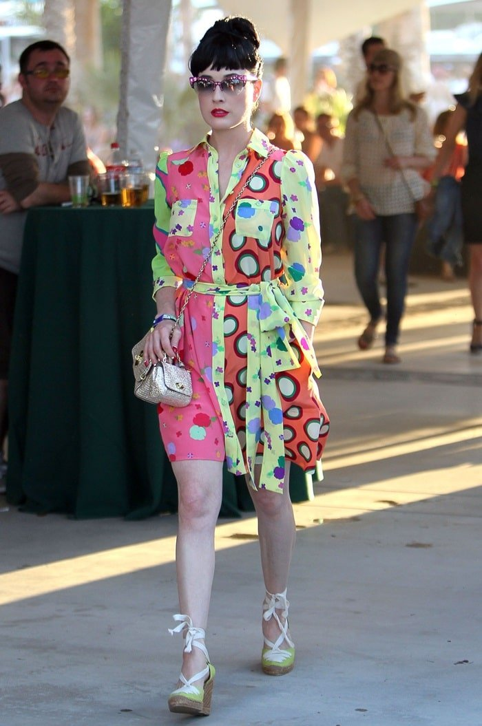 Dita Von Teese in a multicolored shirtdress paired with yellow lace up wedge espadrilles