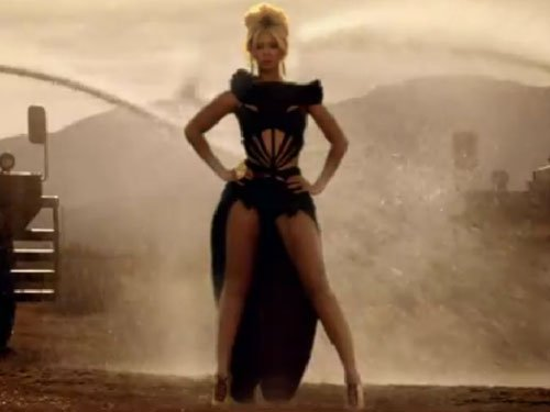 """Beyonce wears gowns from Givenchy and Jean Paul Gaultier during her """"Run the World (Girls)"""" music video"""