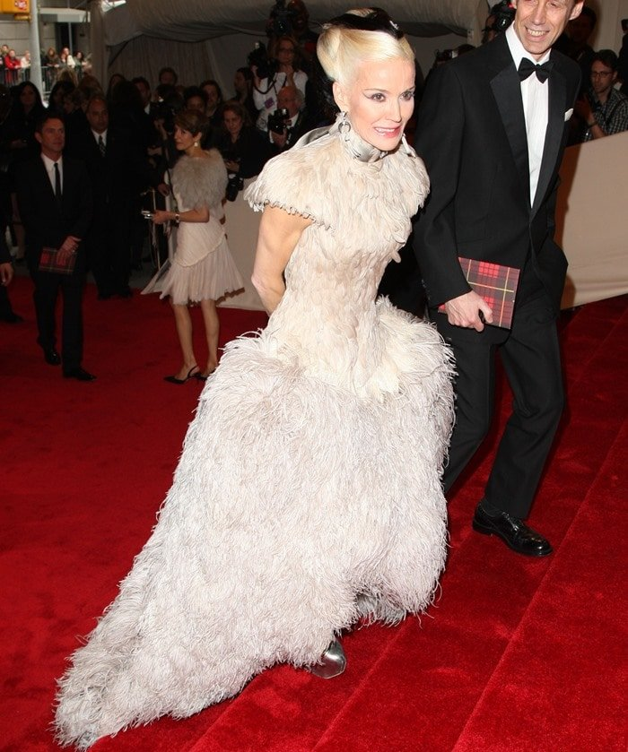 Daphne Guinness in heel-less silver platform Mary Janes