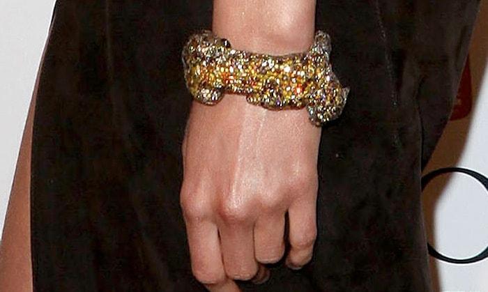 Karolina Kurkova showing off her statement bracelet