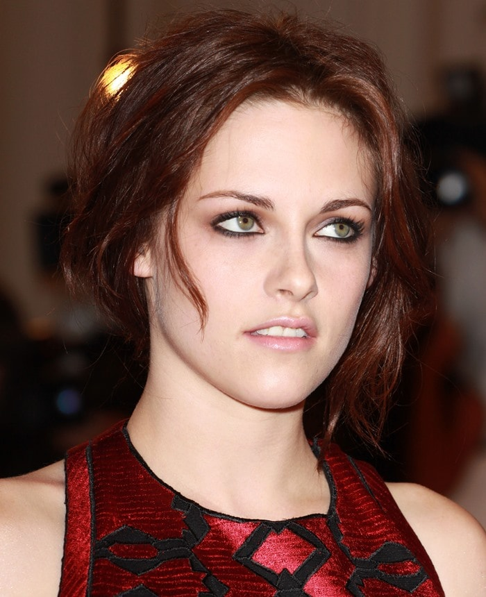 Kristen Stewart in the snake-embossed leather version of the Proenza Schouler Fall 2011 triple buckle strap sandals