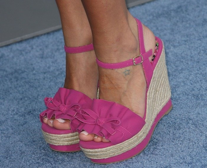 "Kristin Cavallari sporting her ruffled ""Bardot"" fuchsia espadrille wedges"