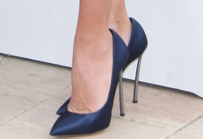 Penelope Cruz in navy blue satin metal heels