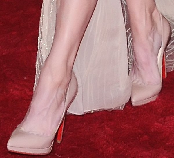 Renee Zellweger shows off her feet inPigalle Plato pumps by Christian Louboutin