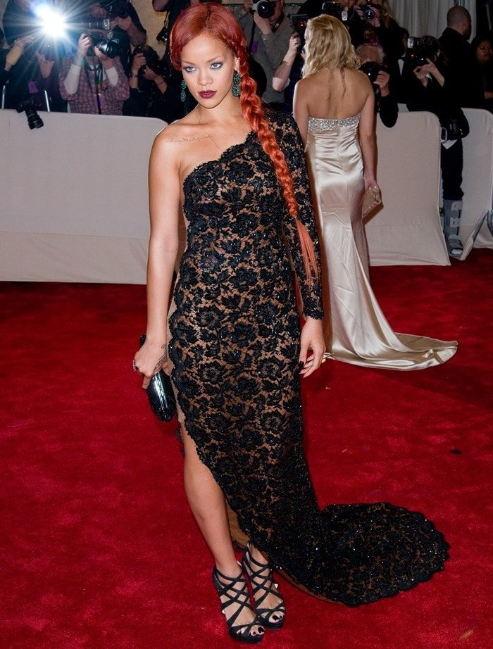 Rihanna in the black suede color of the Christian Louboutin Balota platform sandals