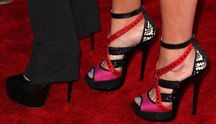Khloe Kardashian wearingsky-high stiletto-platform sandals from Jimmy Choo
