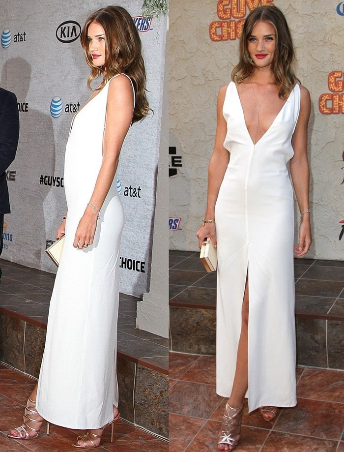 Rosie Huntington-Whiteley shows off the plunging neckline on her ankle-length white dress by The Row