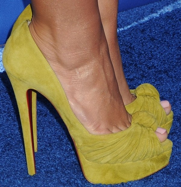 Demi Lovato wearing mustard-hued peep-toe pumps by Christian Louboutin