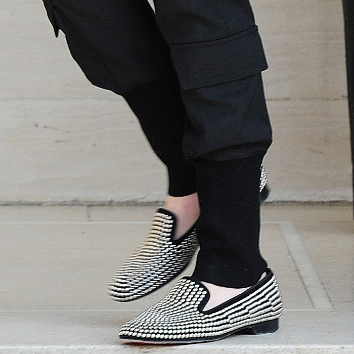 Anne Hathaway's shoes are unmistakably by Christian Louboutin