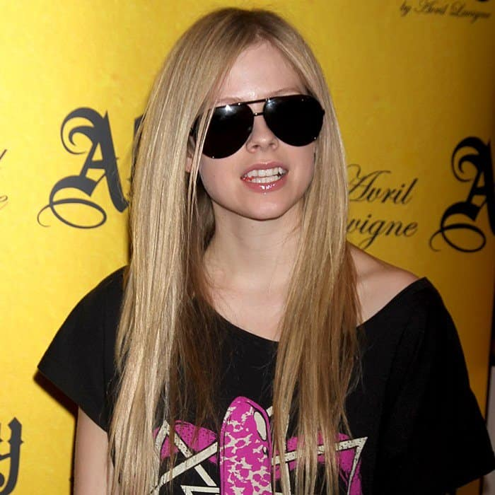 Avril Lavigne promotes her Abbey Dawn clothing line at the Abbey Dawn booth during the 2011 MAGIC Marketplace Convention at the Las Vegas Convention Center on August 22 and 23, 2011