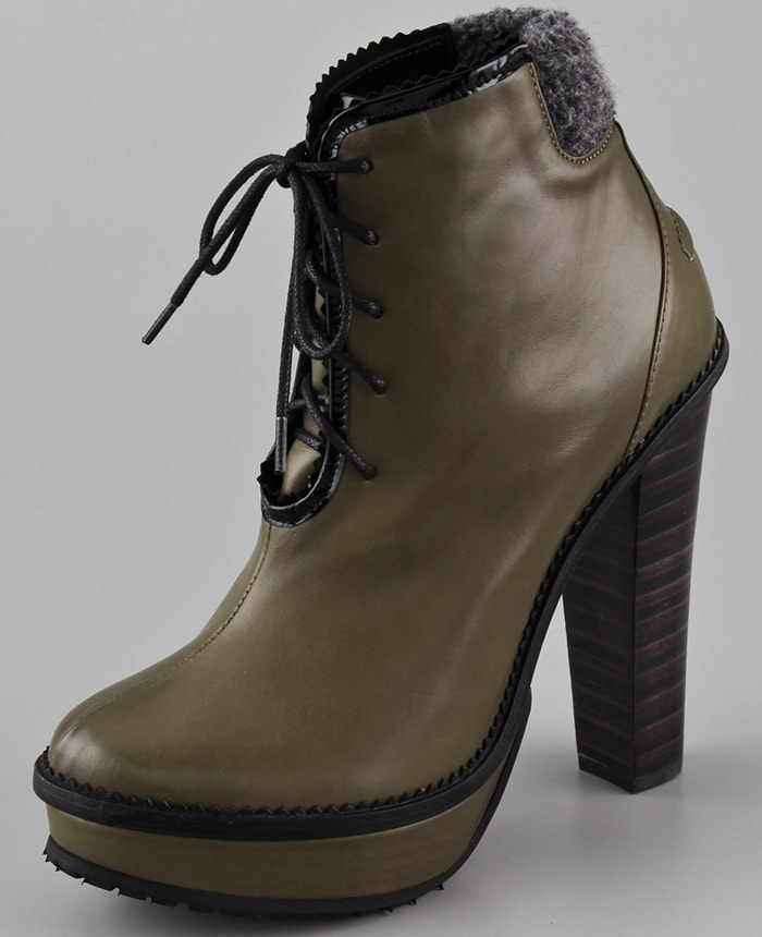 These leather platform booties feature a lace-up front and pinked edges