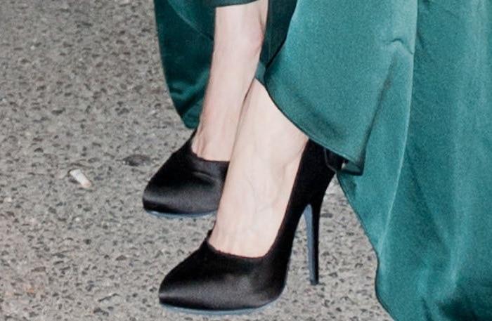 Tilda Swinton wearing Lanvin satin bow pumps