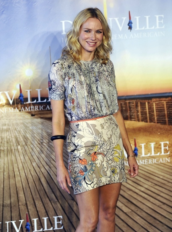 Naomi Watts awkwardly smiles and poses in a Cacharel Fall 2011 outfit combination on the blue carpet