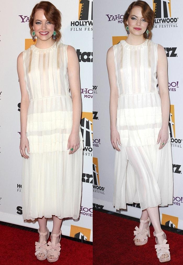 Emma Stone wearinga Jonathan Saunders Spring 2012 ruffled and pleated mid-length sleeveless dress